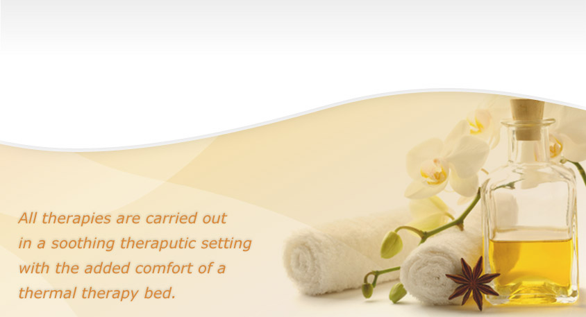 essential oils, flowers and massage towels